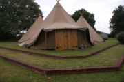 <h5>Tepee with handmade doors</h5>