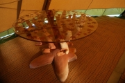 <h5>Handcrafted wooden table with glass top</h5>
