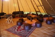 <h5>Beanbags, oriental rugs and low wooden chill out tables</h5>
